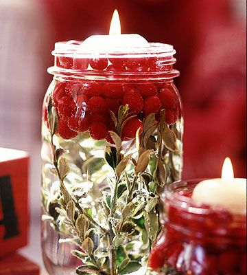 Wash and dry jars and layer the bottom with the greenery of your choice, and then add a handful or two of cranberries. Pour water into the jar, causing the cranberries to float to the top. Insert a floating candle.
