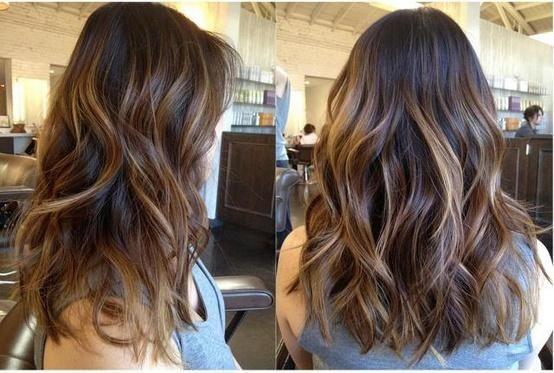 Long Layered hair with caramel highlights