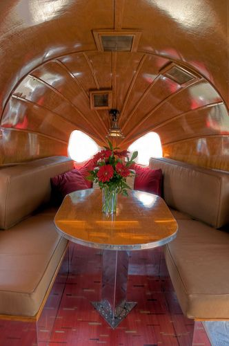 Gypsy Living Traveling In Style| Serafini Amelia| Design Your Wagon| 1936 Airstream Clipper --  this.  this is a slice of heaven.  the wood...steamed  until it could be curved to fit the shape.  bliss.