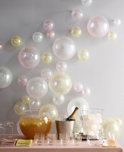 "Add pearl colored balloons to a wall for a ""bubble effect"" that effortlessly makes any reception or engagement party elegant!"