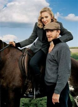 This undated photo supplied by Vogue, shows Madonna on her horse beside husband Guy Richie at the English country estate.
