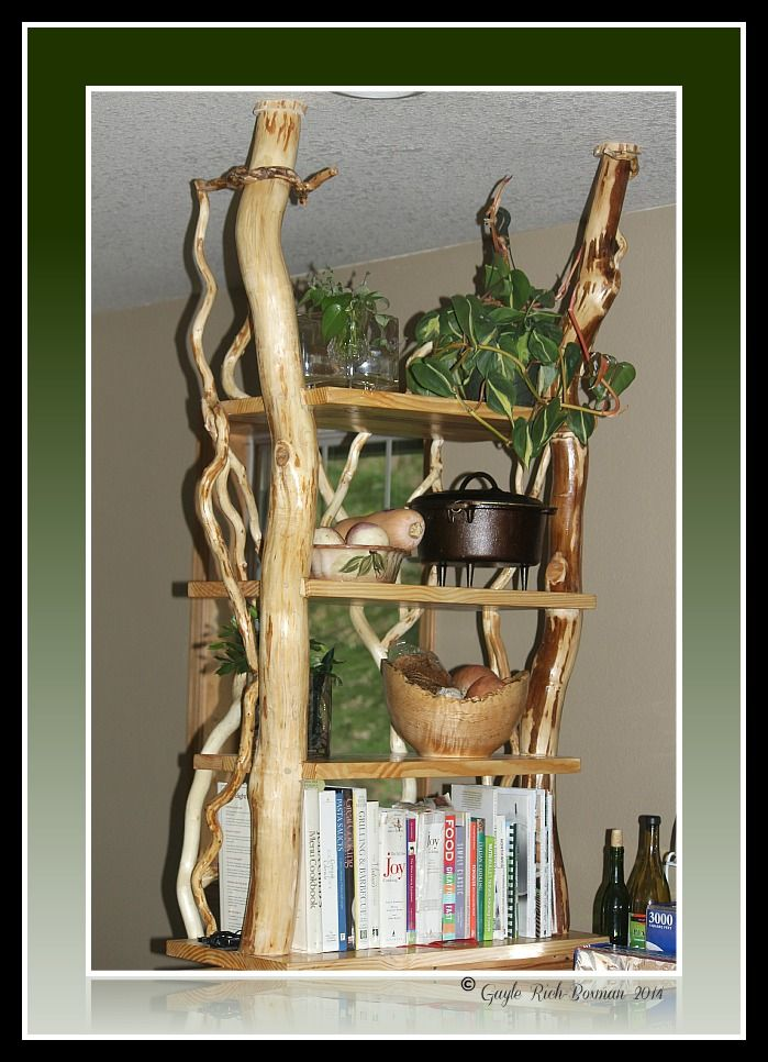 This was custom made by a local Fishhawk Lake member. He created this out of curly willow along with the design help from another local artist, Cheryl Barlow, for her kitchen. The business is called Willowaer, Glenn Waer owner. You can contact him:(503)723-9979 Gayle Rich-Boxman copyrighted all rights reserved 2014 lakehomesatfishhawk.com