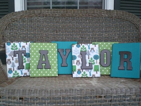 canvas covered with scrapbook paper then painted wood letters. Such a cute idea!