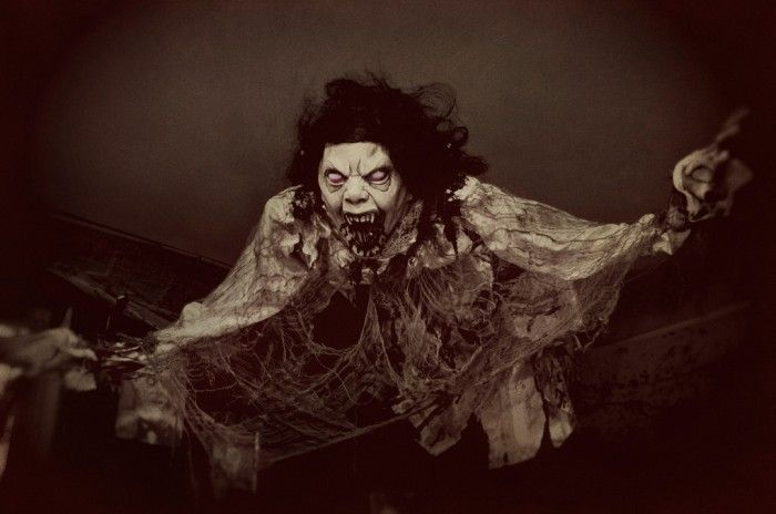 Scary ceiling prop , photo by Holly . Easy to make. A scary mask, an old night gown, and some wire hangers. Suspend with fishing line.