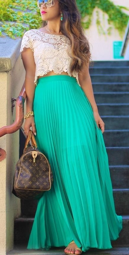 Wear your maxi skirt with a crop top. Wear it higher on your waist so you show very little skin, or wear it lower to bare your stomach. Whatever you're comfortable with! Read more: http://www.gurl.com/2014/04/05/style-tips-how-to-wear-a-maxi-skirt-for-any-season/#ixzz321B2l78n