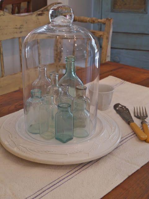 Vintage bottles under a cloche