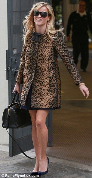 She really is Wild! Reese was spotted wearing a leopard print coat in LA on the day of the...