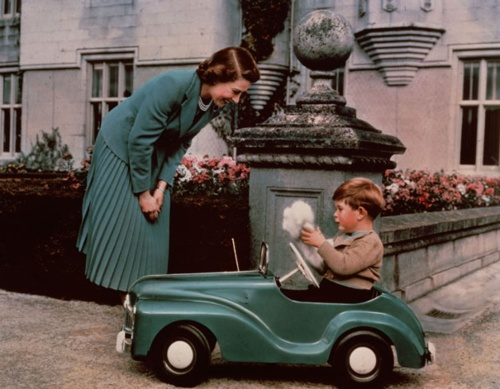 The Queen playing with a little Prince Charles, at Balmoral, 1952.
