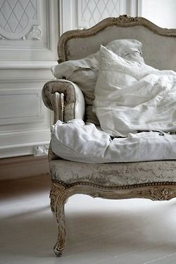 shabby chic white chair and pillows