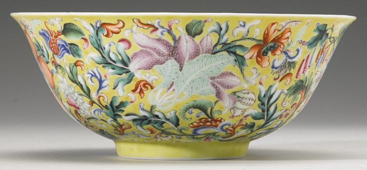 A fine and rare yellow-ground enameled 'Floral' bowl, Qianlong seal mark and period.