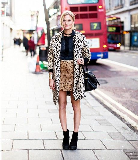 street style tip: adeptly mix prints and patterns - most people are intimidated by the idea of mixing prints, but as long as you work within a similar color scheme, it's actually a very simple way to make a big, stylish impact.  Try something like this leopard-on-leopard look, just make sure the prints are different sizes...