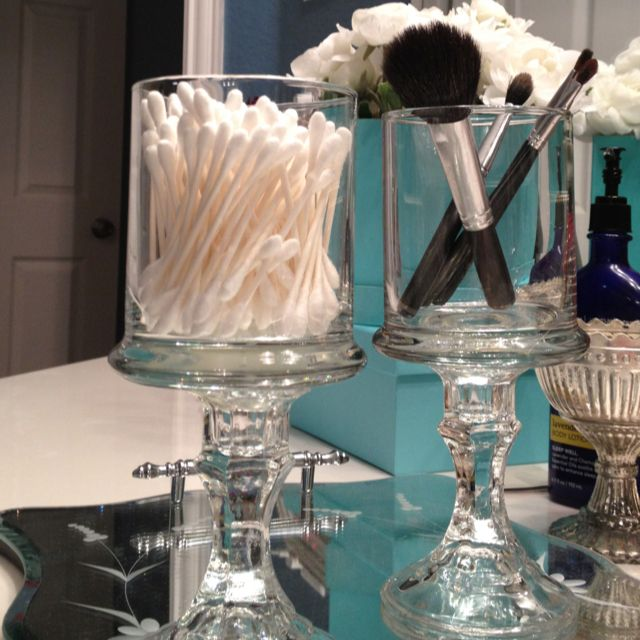 Dollar Tree candle sticks hot glued to Dollar Tree votive candle holders. Possibly for the bathroom if we dont do the vanity tray idea you had (Just a possibility) :)