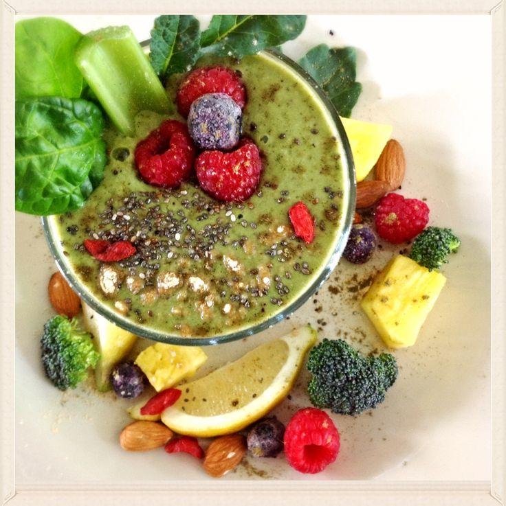 Green superfood smoothie. Maca, goji berries, hemp powder, chia seeds, spirulina, turmeric, celery, kale, spinach, broccoli, pineapple, raspberries, raw almonds, coconut milk, water and ice! Enjoy!