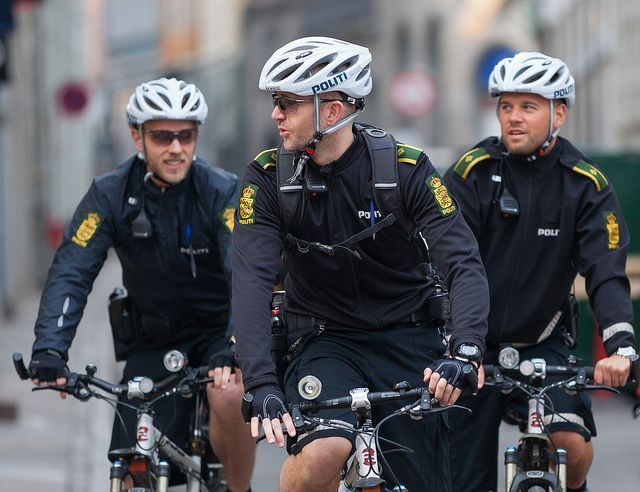 You definitely won't see cops on bicycles in most of the United States, but Copenhagen is a different place. They even make bicycle helmets (which cops for sure wouldn't have here) look great and not nerdy.