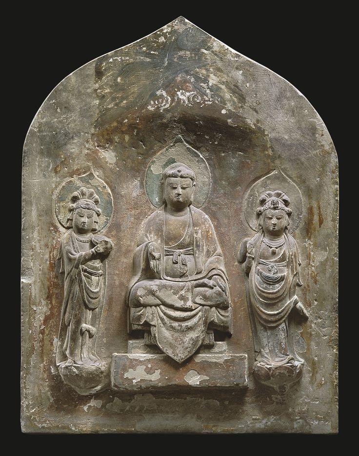 A polychromed limestone 'Buddhist Triad' stele, China, Tang dynasty, 8th-9th century