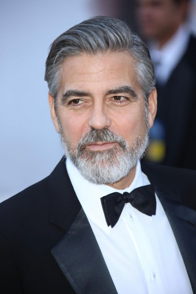 Embracing Gray Men's Hairstyle How-To... George Clooney Rocks This Hair...Deep side parted, longer crop is left longer on the top and cut closer on the sides and in the back..