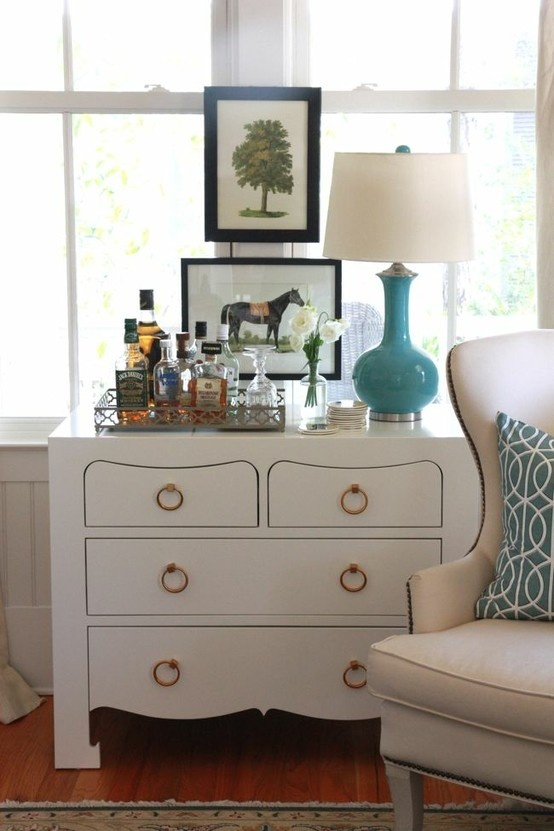 I really like this dresser. It's a cool idea to use it as a bar in the corner of a living room.