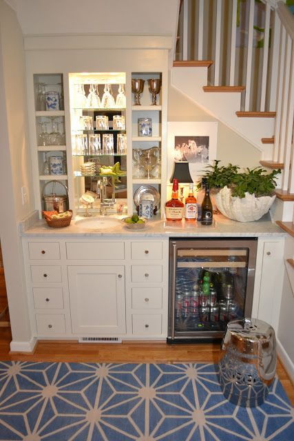 Cute idea for small spaces - bar under the stairs in a basement.