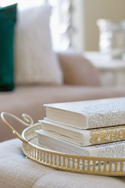 """I like her attitude and philosophy about decorating.   """"Progress over perfection."""" There are several good ideas in here.   I'll be pinning a couple,  including this metallic doily book cover.   [50 Budget Decorating Tips]"""