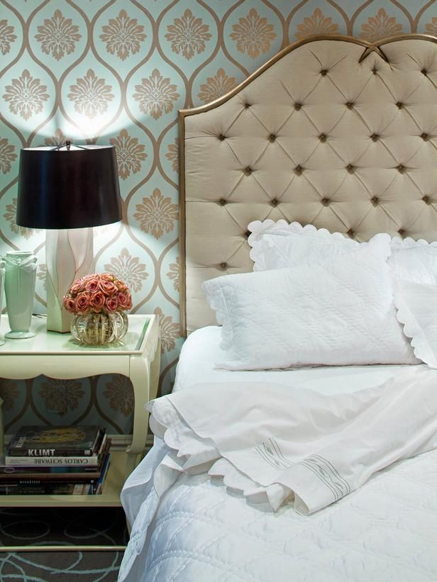 Designer Jamie Herzlinger chose a metallic paint design on colored wallpaper to create a dramatic look in this contemporary guest bedroom. To balance the space, she chose a neutral, solid headboard and accessories. Add fresh flowers in a feminine vase to soften the look and bring a smile to guests faces, she suggests.Share This Photo Gallery  Facebook Twitter Link to this Photo Gallery: