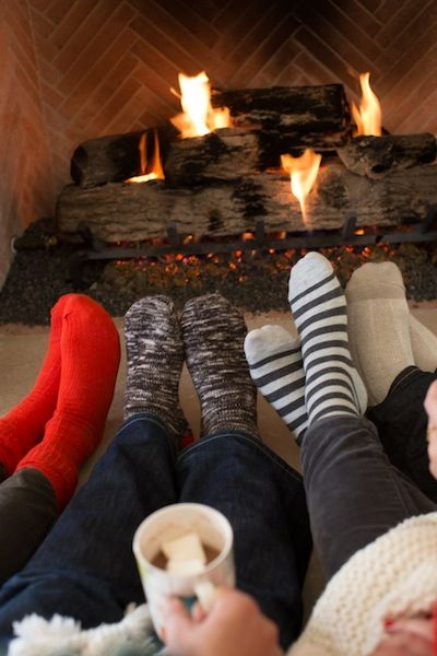 Cozy up.    Encourage guests to kick off their shoes and stay awhile by setting baskets of cute socks near the fire that they can slip on. Lots of blankets and floor pillows enhance the lounge-y vibe, though be forewarned: you're guaranteed to have a few guests linger way past dinnertime!