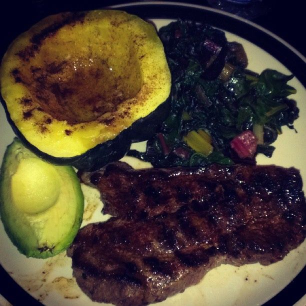 Grass fed steak with sauteed, locally grown swiss chard, baked acorn squash with cinnamon and a 1/4 of an avocado sprinkled with sea salt. #paleo