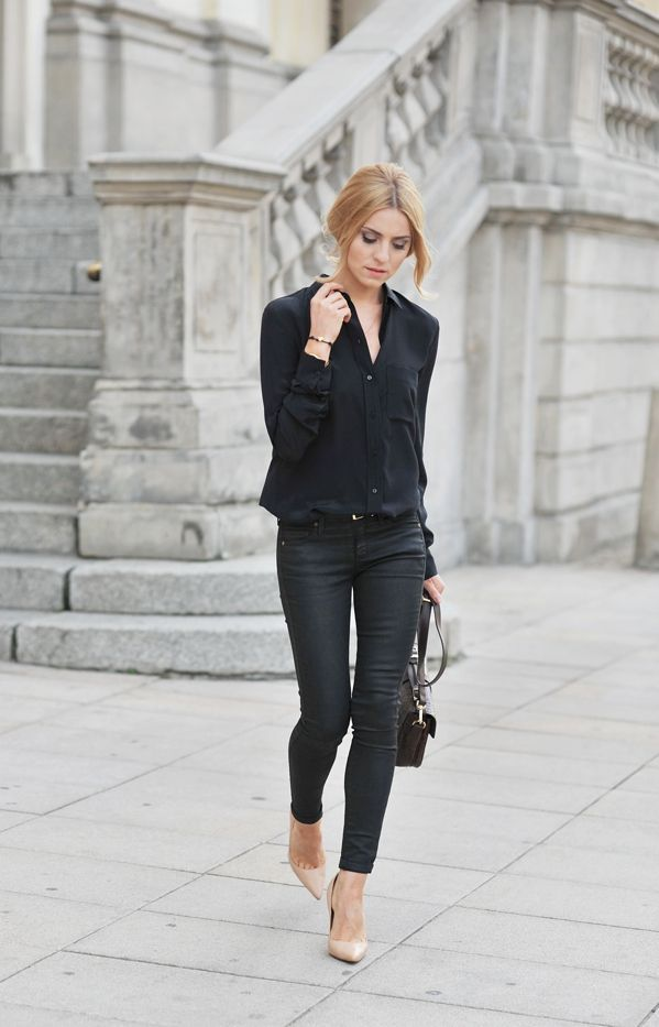 all black outfit: black blouse shirt with black trouser pants, black purse paired with beige shoes