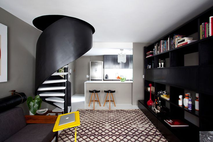 Home designed by Maurício Arruda. Love the stairs and wall unit!