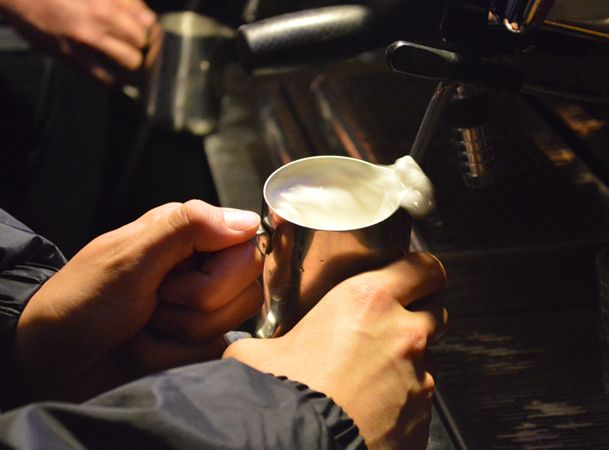 A barista steams milk for the 'Barista Throwdown' competition.