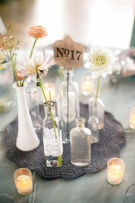 This idea, with a couple mason jars, couple skinny vases, and chalkboard table number. @Karen Gniadek Moehlenpah @Molly Simon Ray