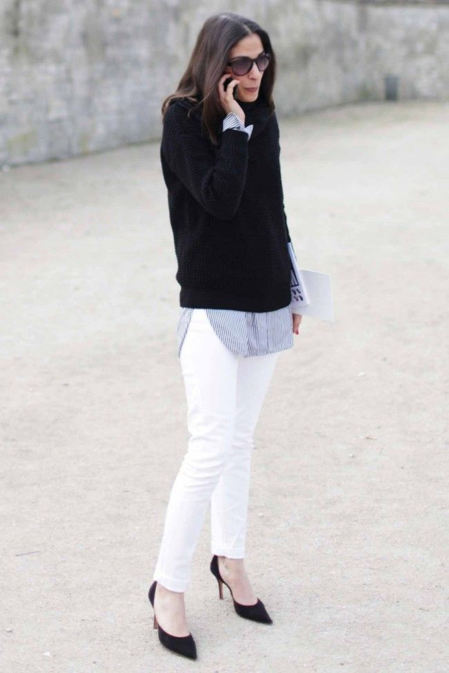 Back to black Who doesn't have a black knit in their wardrobe? Update yours by wearing it with winter white jeans and matching black heels for impact. Soften the effect with a men's style shirt layered underneath, like Paris Vogue's Capucine Safyurtlu.