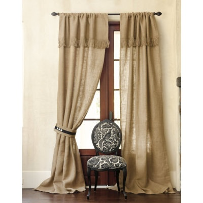 Burlap curtains with fringed valance.
