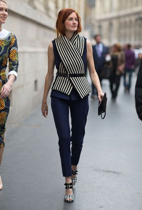 Street Style: Paris Fashion Week Spring 2014  This looks like scarf but how neat would it be to do this with fabric to a simple blouse?