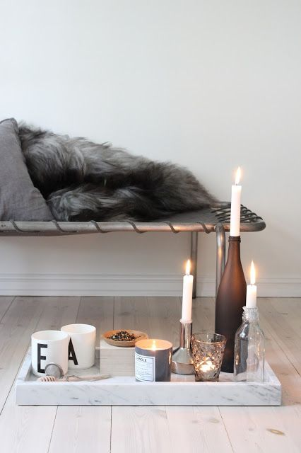 You can find up and coming marble trays almost anywhere. Although they are quite heavy and chunky, they look really nice, smooth and light especially on wood or white furniture as shown here. Combine it with some candles to make a contrast to the cold material and it will look perfect.