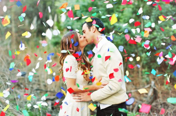 Couple Kissing in Confetti | photography by http://www.priscilavalentina.com @Renee Rice - love love this!