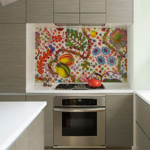 Do you remember IKEA's colorful kitchen backsplashes from a few seasons ago? What looked at the time to be elaborate tile or mosaic patterns was actually just IKEA fabric hung behind plexiglass! Since then this idea has popped up around the internet as one DIY backsplash solution for rental kitchens.