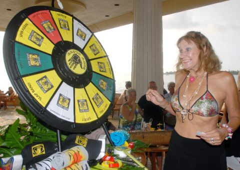 A spinner is excited to spin at Body Glove's 60th anniversary party.