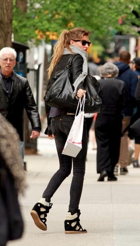 Gisele in Isabel Marant sneakers.
