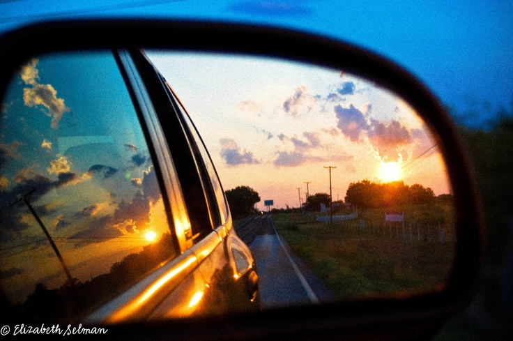 Sunset through the car side view mirror