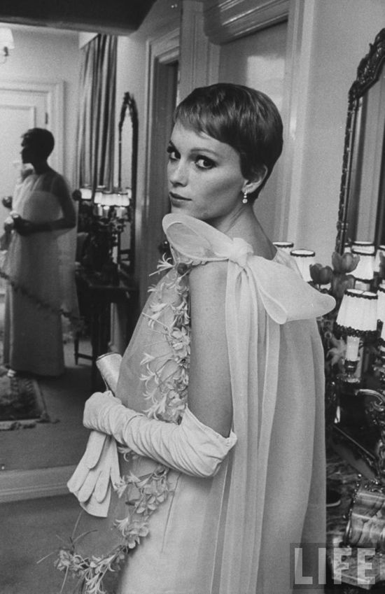 Mia Farrow in this chiffon gown by Pierre Cardin. She was photographed here at Frank Sinatra's town house in 1968