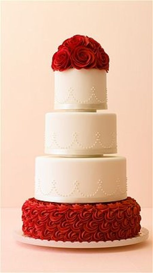 Philip Ficks / The Knot - Bold and beautiful cake designs are big for winter -- like this red-rose-bedecked white wedding cake.