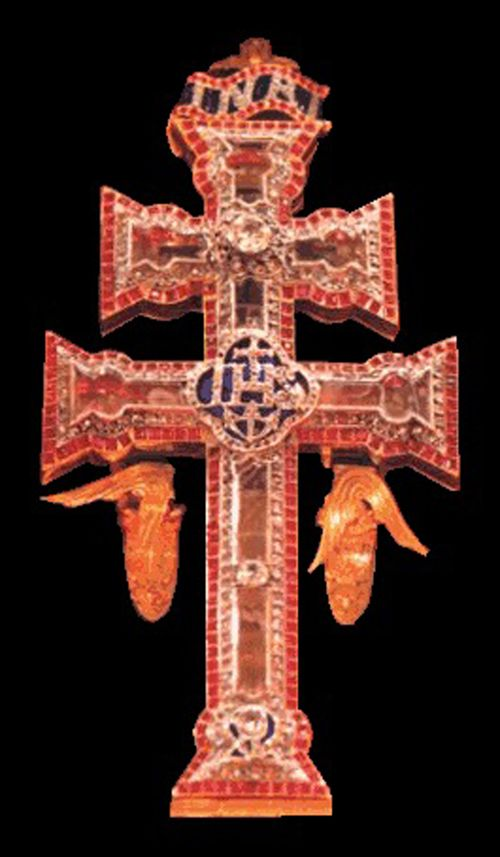 La Cruz de Caravaca relic of the True Cross of Jesus at in the Basilica of the Real Alcázar de la Vera Cruz in Caravaca de la Cruz (Murcia , Spain). According to legend, the Cross, originally belonging to the first patriarch of Jerusalem after the conquest of the city to the Muslims was miraculously brought to the castle-sanctuary Caravaca by two angels, who are also part of the imagery that makes up the cross.
