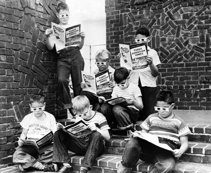 1953. Kids reading the first 3D comic.