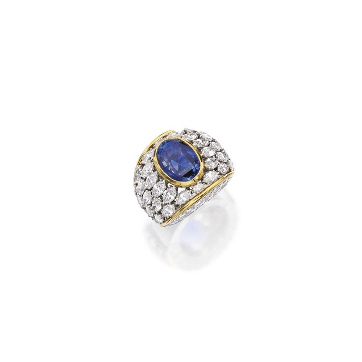 Platinum, 14 karat gold, sapphire and diamond ring, David Webb