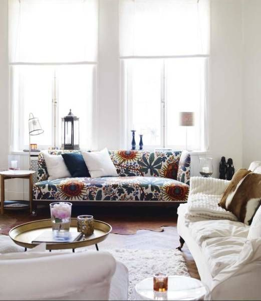 patterned sofa, white room