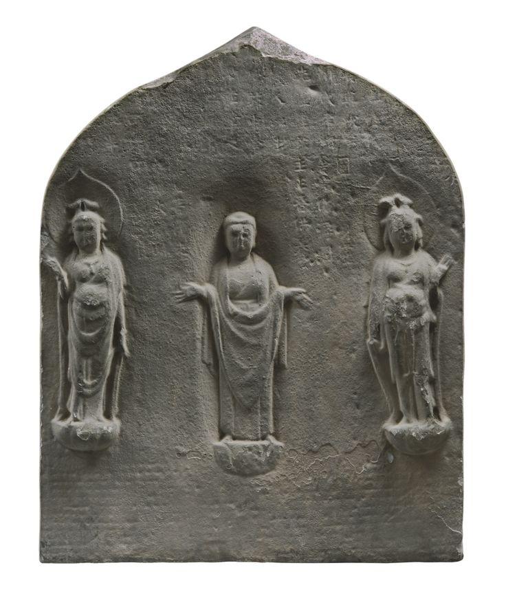 A polychromed limestone 'Buddhist Triad' stele, China, Tang dynasty, 8th-9th century.