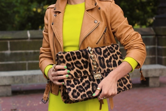 Leopard Clutch. Yellow Dress. Beige Leather Jacket. Gold Thumb Ring.