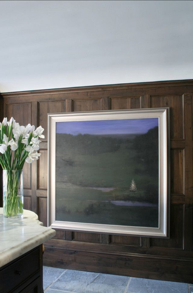 Large art piece opens up to cabinet storage behind