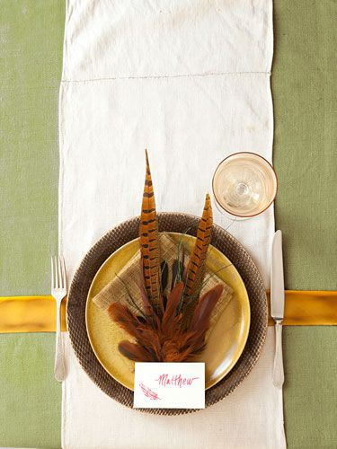 A sophisticated way to signal the season: with rich russet-toned pheasant plumes. Continue the theme with feather-stamped name cards, and tie it all together with a gold satin ribbon running from plate to plate.