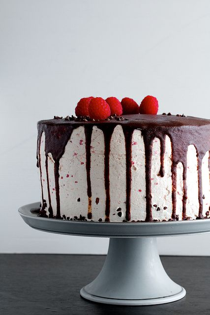 CHECK OUT THIS SITE if you breathe and eat. I cannot believe the awesomeness contained on this blog. And yes, instructions on how to make this Dark Chocolate Raspberry Buttercream cake with Ganache drizzle are there (you do have to click on the individual link)